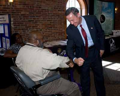 Governor Martin O'Malley greets a disabled worker on the 20th Anniversary of the Americans with Disabilities Act